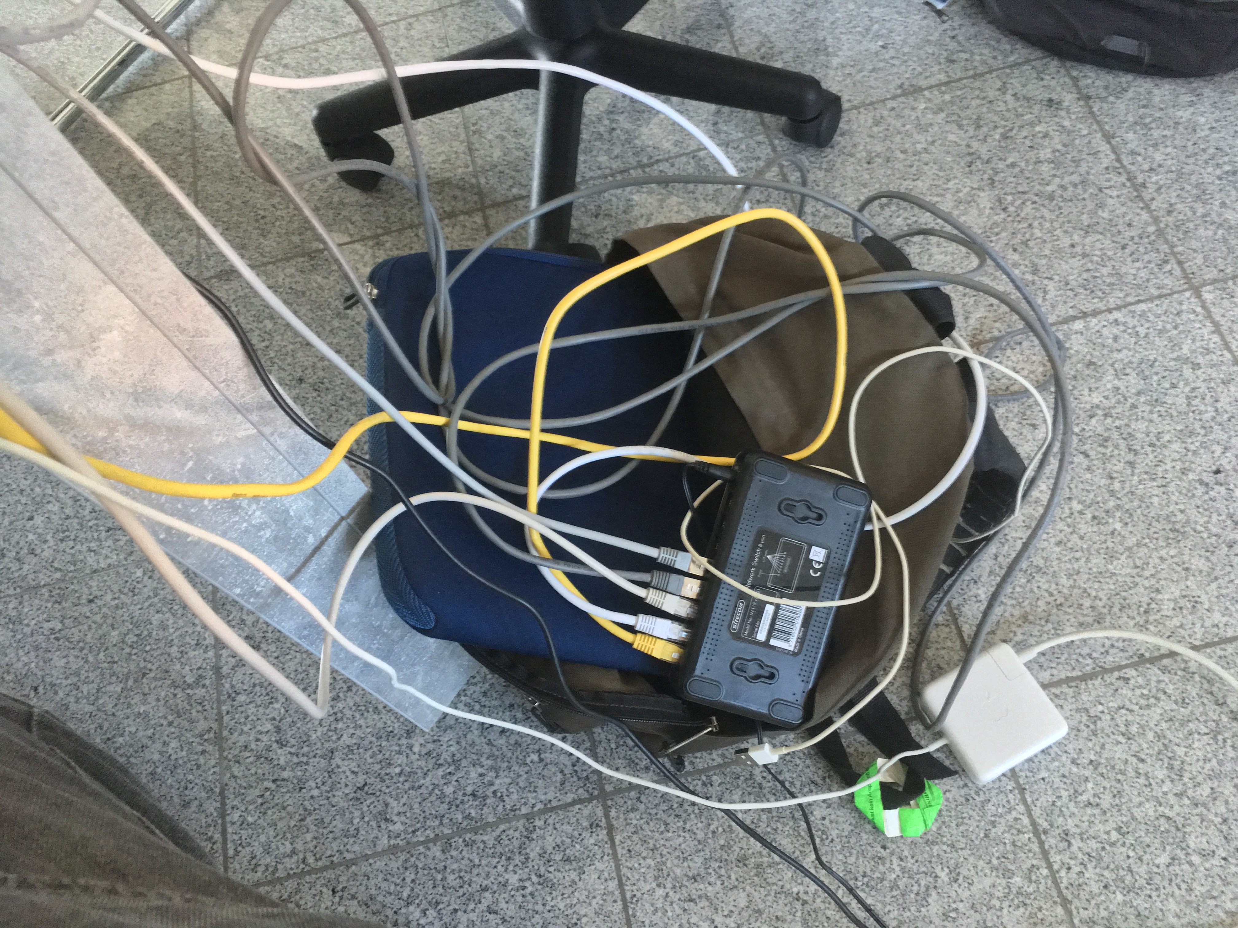 A bunch of network cables connected to a switch